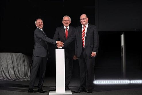 Prof. Dr. Ulrich Hackenberg, Member of a Board of Management for Technical Development AUDI AG (in a middle), Ricky Hudi (right), Head of Development Electrics/Electronics during Audi, and Dr. Wolfgang Huhn (left), Head of Development light/view during Audi, start a biggest automotive light hovel in Europe.