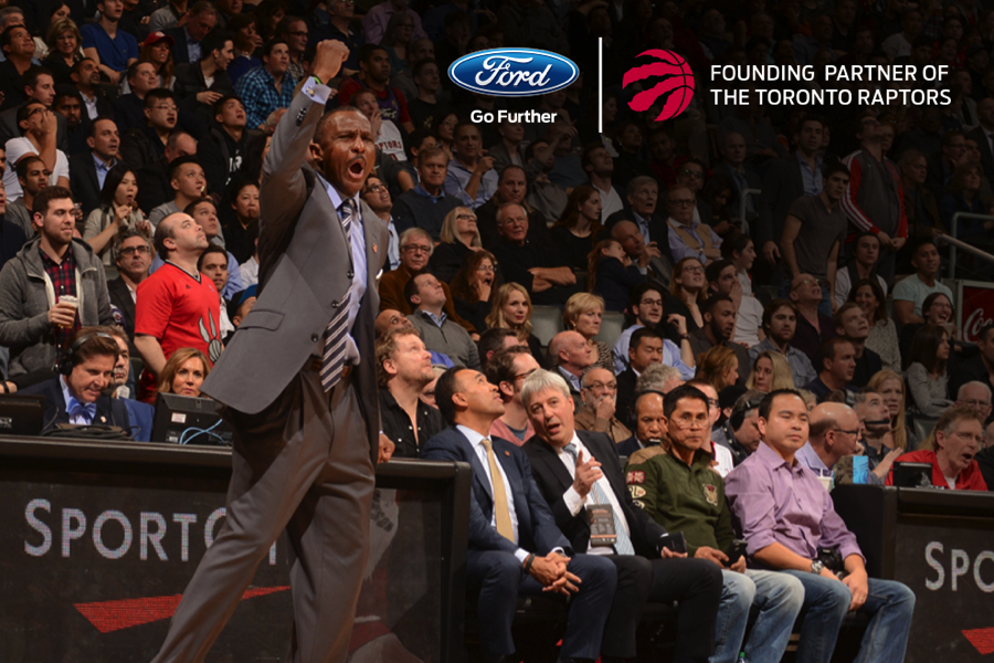 Raptors manager Dwane Casey opening a vehicle uncover with Ford