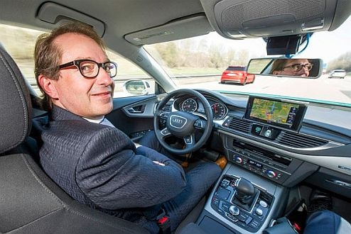 German Federal Minister of Transport Dobrindt tests piloted Audi.
