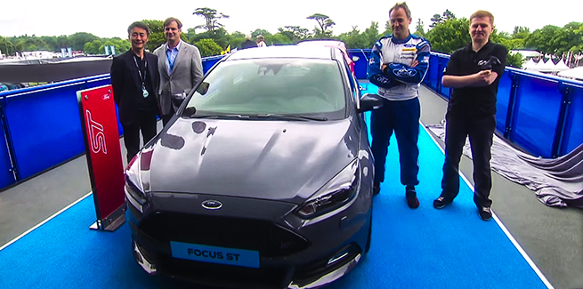 Jim Farley, Executive Vice President of Ford and Kazunori Yamauchi, Creator of a GranTurismo® array poise with a drivers of a 2015 Ford Focus ST.